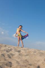 Pretty girl walking by the sea