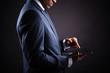 Businessman working on a digital tablet against black backgroun
