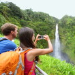 Tourist couple on Hawaii taking pictures