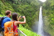 Couple tourists on Hawaii by waterfall