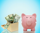 Piggy bank with a box of bills