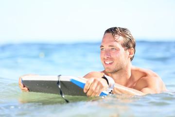 Beach fun - man bodyboarding on bodyboard