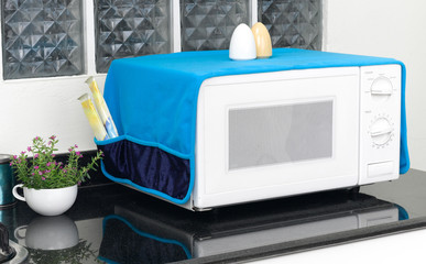 microwave oven with the cover blanket to protect dust or dirty