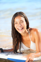 Water sport fun - beach woman bodyboarding surfing