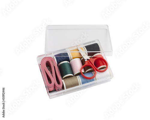 mini sewing set in plastic box isolated on white background