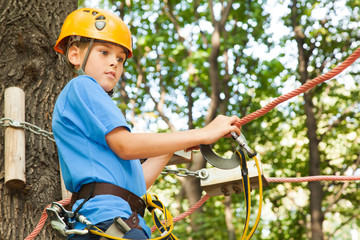 Young guy with climber equipment focused  for moving.
