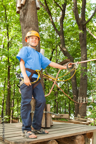 Young boy with equipment climber happy success.