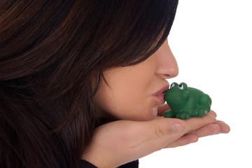 pretty woman kissing a frog