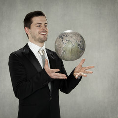 joyful businessman is playing planet