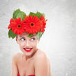 woman with red gerbera flowers on her head