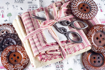 Buttons and Scissors on Fabric