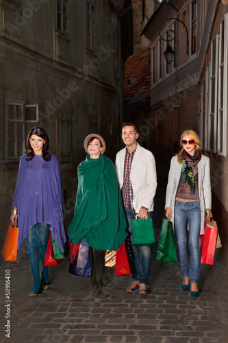young people walking with shopping bags