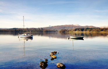 Two boats on Windermere with mountain backdrop