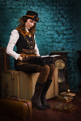 Steam punk girl and old typewriter