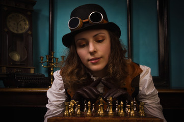Steam punk girl plays chess