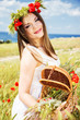 beautiful girl in a poppy wreath. spring time