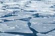 Winter background, blocks of ice on frozen blue Sea