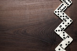 domino pieces forming zigzag over wooden table