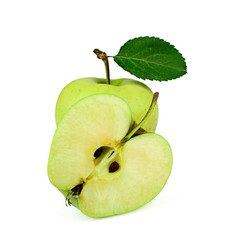 Green apple with leaf and half