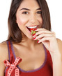 Healthy woman eating strawberry