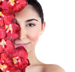 Woman with orchid flowers on face