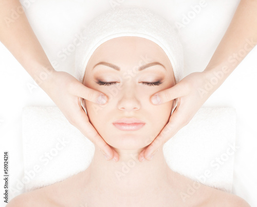 Portrait of a young woman relaxing on a spa massage