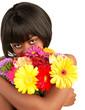 Black female smelling flowers