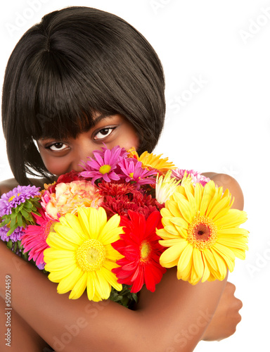 Black female smelling flowers