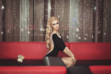 Fashion blonde woman in hotel party. Hairstyle and make up