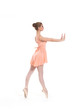 Young beautiful ballet dancer isolated over white background