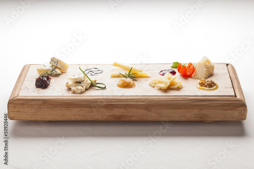 Cheeseboard with italian Cheeses ready for degustation. Gourmet