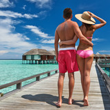 Couple on a beach jetty at Maldives
