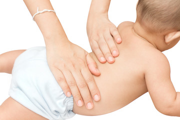 Baby back massage with mother hand