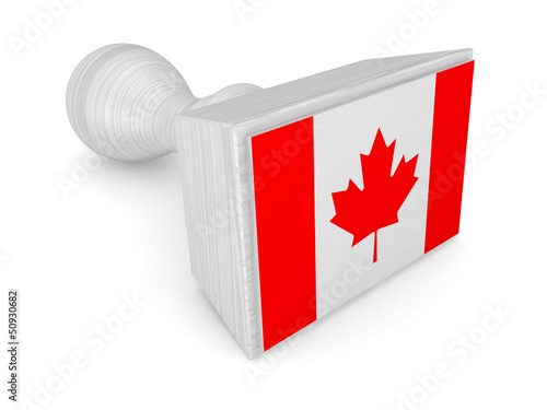 Wooden stamp with canadian flag.