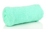 Rolled up turquoise towel isolated on white