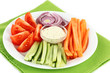Assorted raw vegetables sticks in plate close up