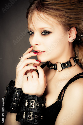 beautiful sexy girl in leather handcuffs