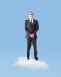 Senior business man standing on a cloud