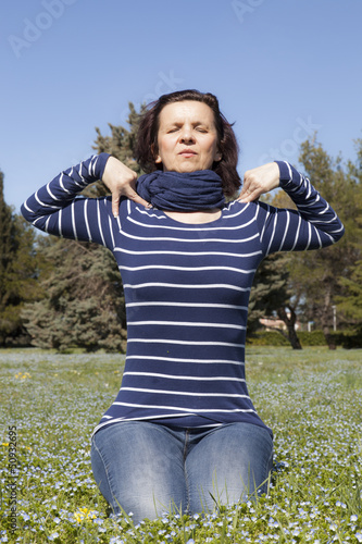 Mid aged woman doing yoga exercises
