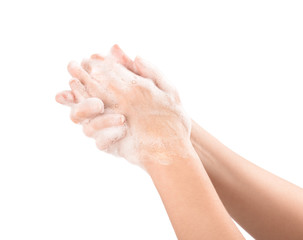 Woman hands in soapsuds