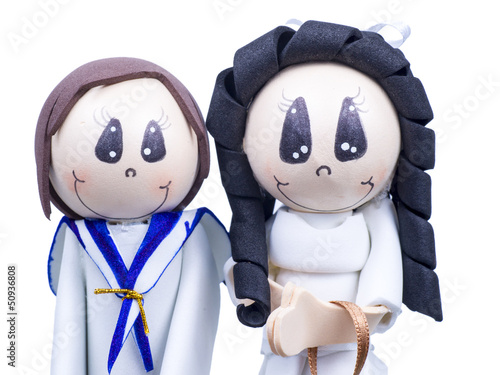 Small Figures of Children Dressed for First Communion