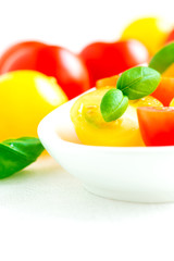 Assorted colorful red and yellow cherry tomatoes in plate close