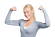 Woman in grey sweater showing her strong muscles