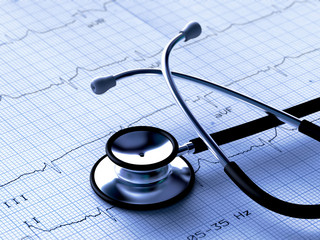 Black stethoscope and ECG