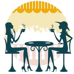 Dos amigas tomando un café o té y charlando