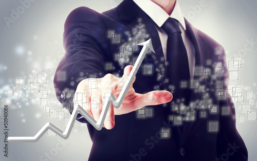 Businessman Touching a Rising Arrow
