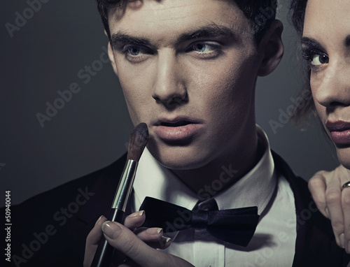Portrait of a woman doing make up his man