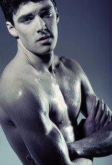 Muscular young man without T-shirt