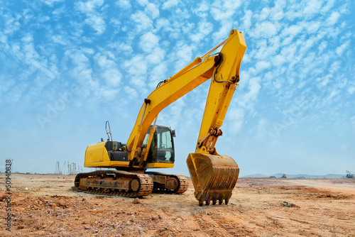 excavator loader machine during earthmoving works outdoors
