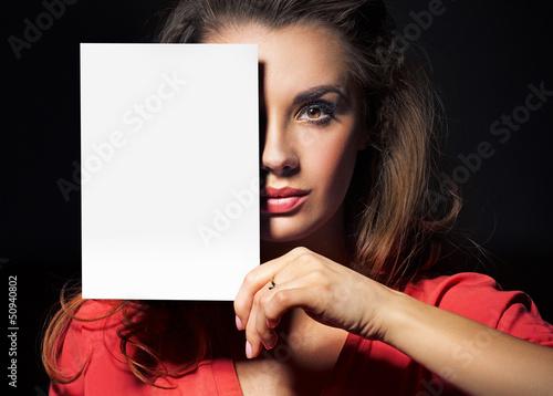 Beautiful lady holding an empty white sheet